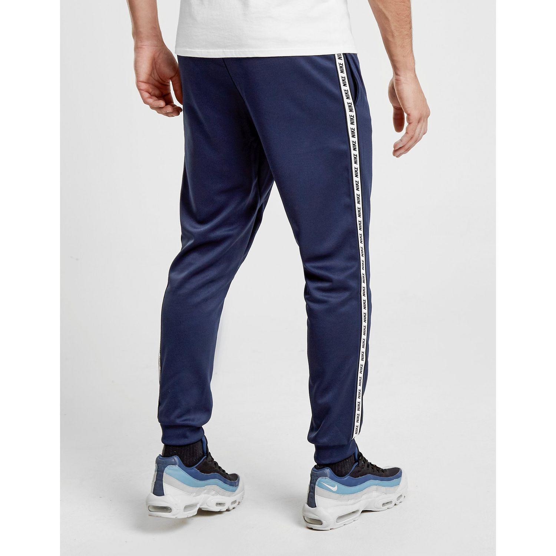 Cálculo Enumerar deseo  Nike Synthetic Gel Tape Cuffed Track Pants in Blue for Men - Lyst