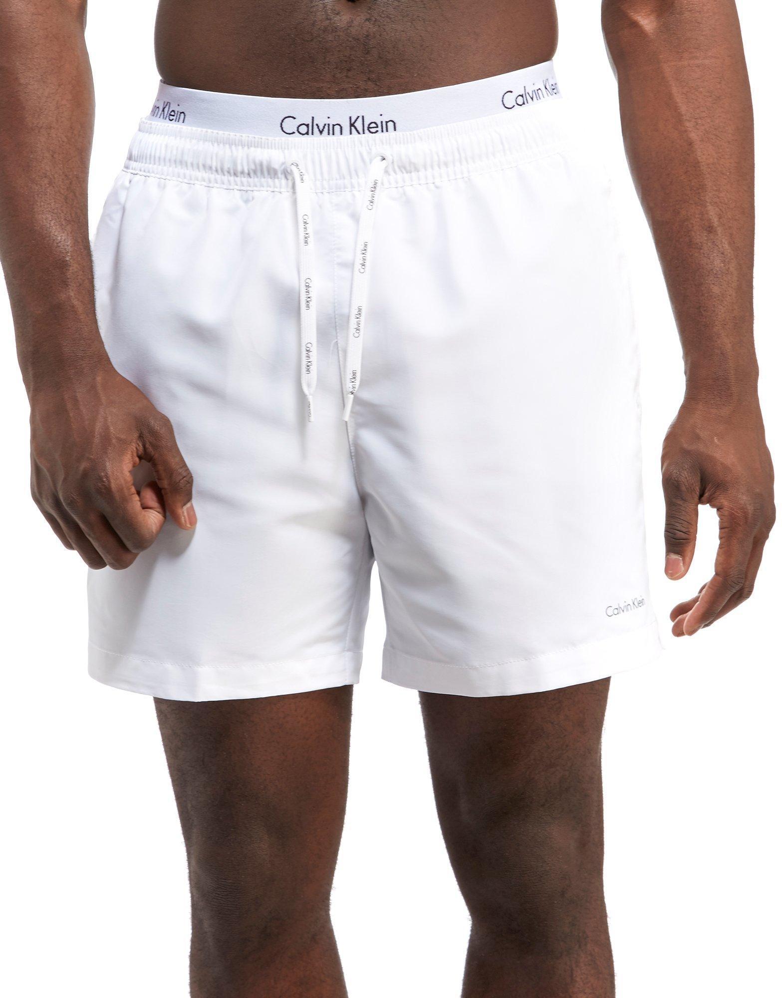 calvin klein double waist band swim shorts in white for men lyst. Black Bedroom Furniture Sets. Home Design Ideas