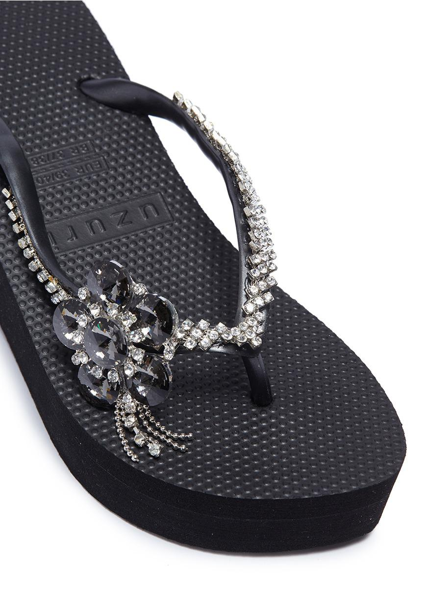 9e84dc468e09 Lyst - Uzurii  swan  Floral Embellished Wedge Thong Sandals in Black