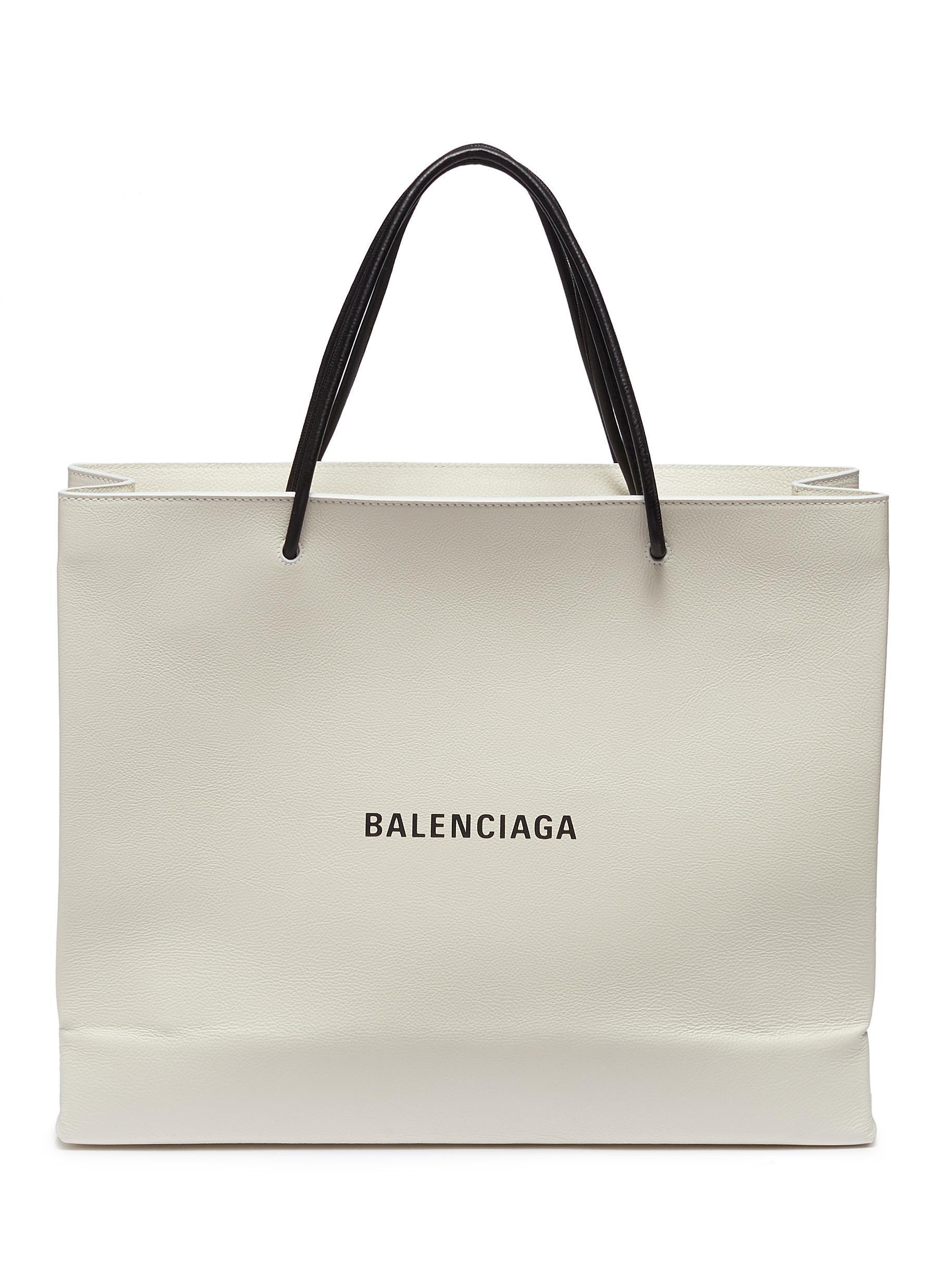 Balenciaga - White  east-west  Logo Print Medium Leather Shopping Tote Bag  for beab3a8208f12