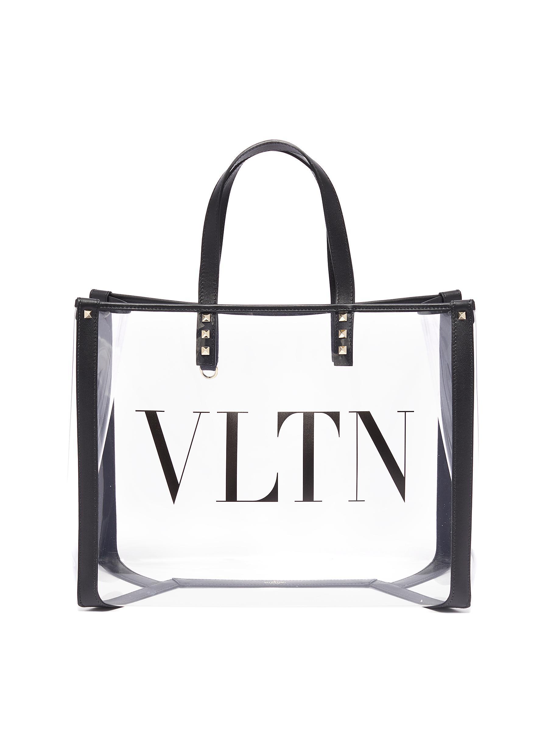 7c633750e Lyst - Valentino Rockstud Logo Print Pvc Tote in White
