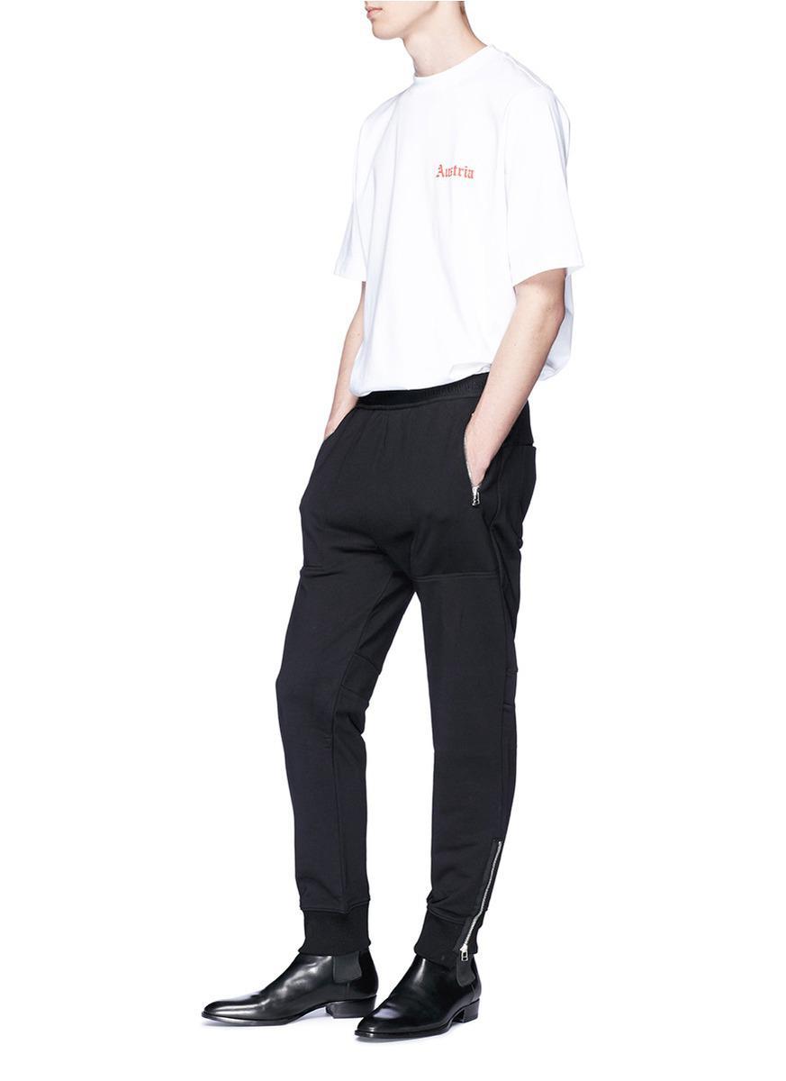 Helmut Lang Cotton Logo Embroidered Tapered Leg Jogging Pants in Black for Men