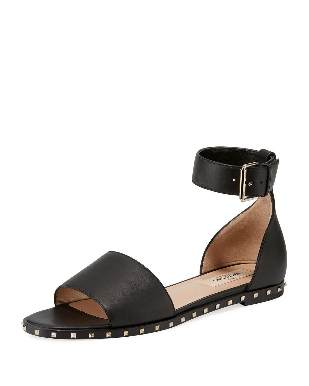f4f0ef8cf9da Lyst - Valentino Rockstud Leather Ankle-strap Flat Sandals in Black ...