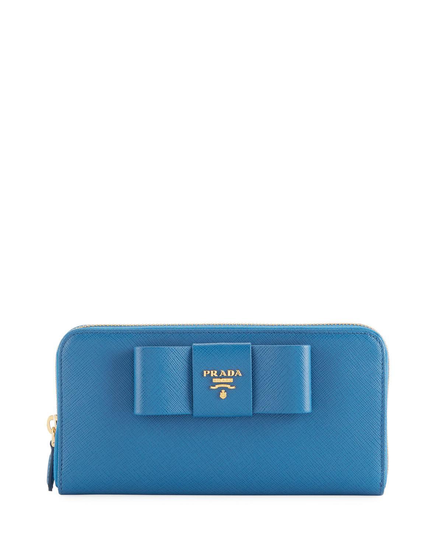aa0bb9c3b232 Prada Saffiano Bow Zip Around Wallet in Blue - Lyst
