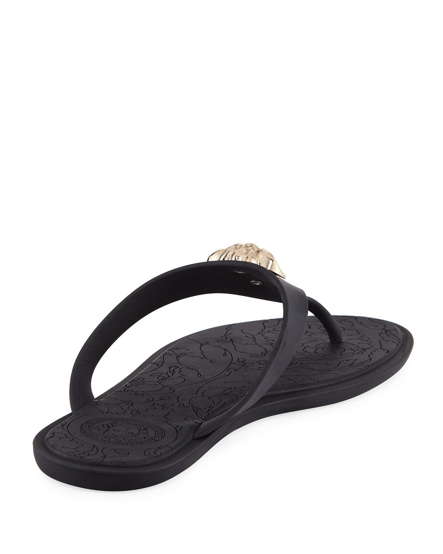 9ec4042475ce Lyst - Versace Gold Medusa Flat Slide Thong Sandal in Black