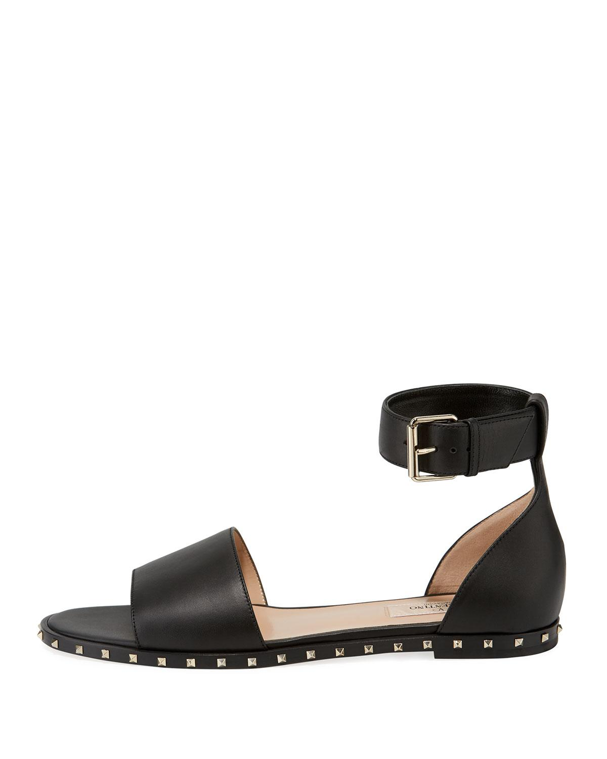 d478e3c73c70 Lyst - Valentino Rockstud Leather Ankle-strap Flat Sandals in Black - Save  6.71641791044776%