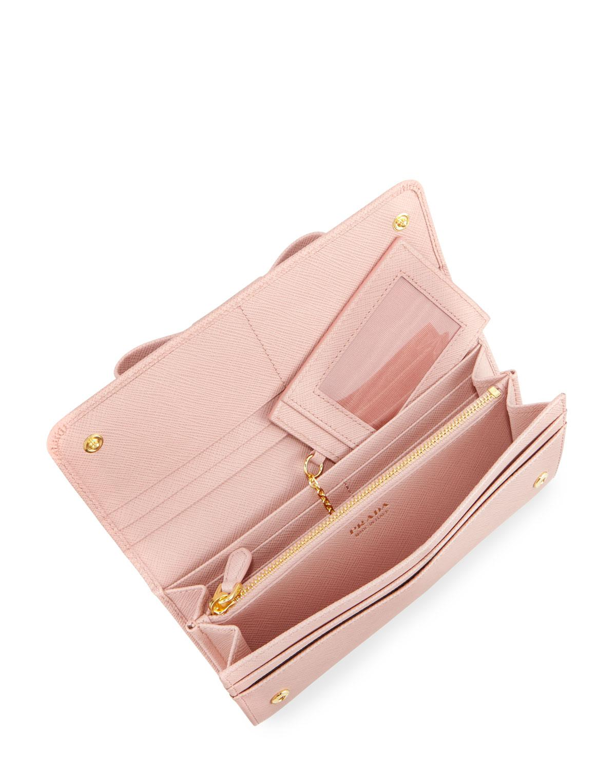 50f0addb2a3e ... france prada saffiano continental flap wallet with bow in pink lyst  5edc8 c17d4 ...
