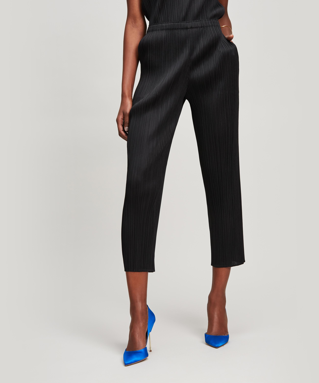 1177e2dd35735 Lyst - Pleats Please Issey Miyake Basic Slim Trousers in Black
