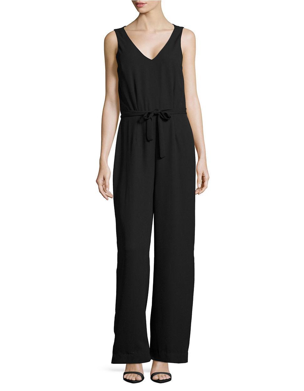 vero moda belted crepe jumpsuit in black lyst. Black Bedroom Furniture Sets. Home Design Ideas