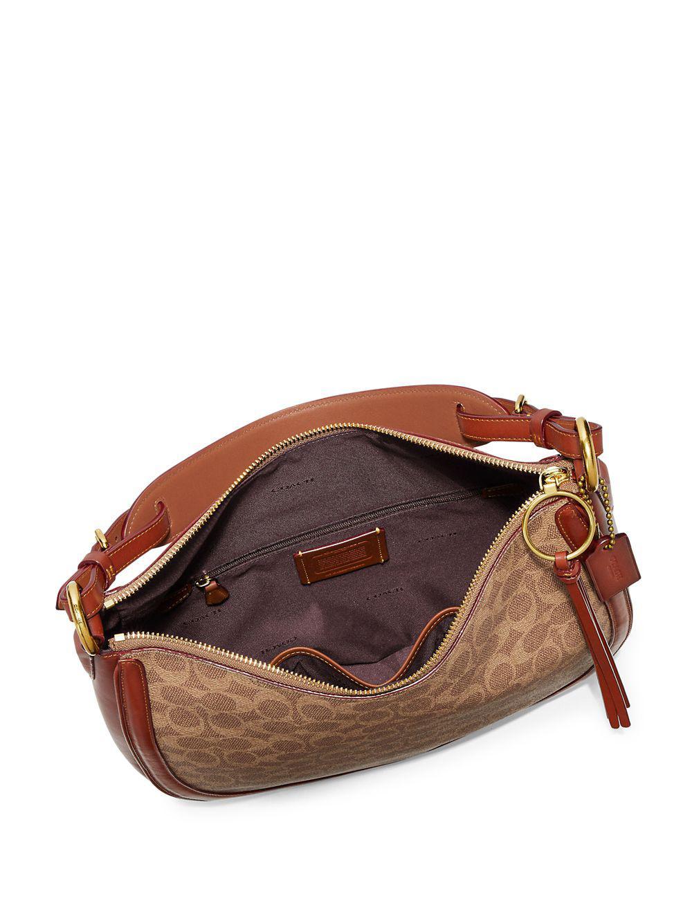 ... buy coach natural signature canvas and leather sutton hobo bag lyst.  view fullscreen c0b70 6e698 fcfc522434e7a