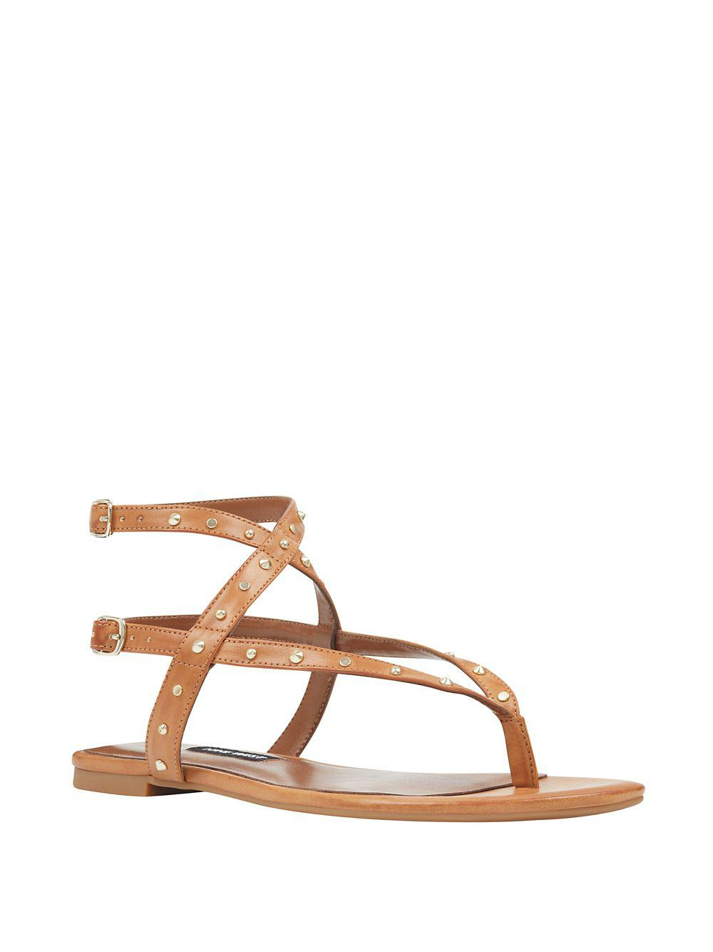 048942b1709 Lyst - Nine West Simcha Leather Ankle-strap Thong Sandals in Natural
