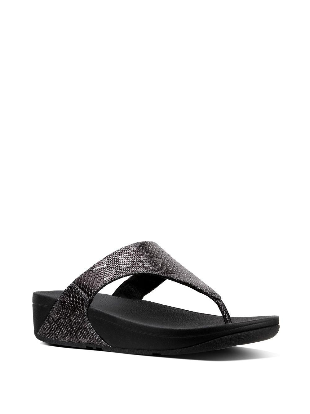 aa905a637b13 Lyst - Fitflop Lulu Leather Wedge Thong Sandals in Black