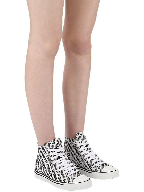 6779dcb62f7d1f vetements-WHITEBLACK-20mm-Logo-Print-Canvas-High-Top-Sneakers.jpeg
