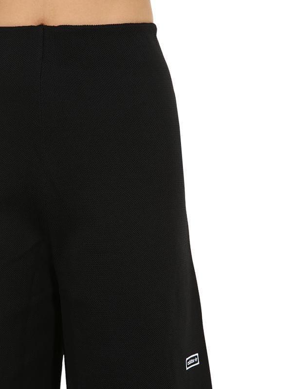 Damen Trainingshose Aus Technostoff in schwarz