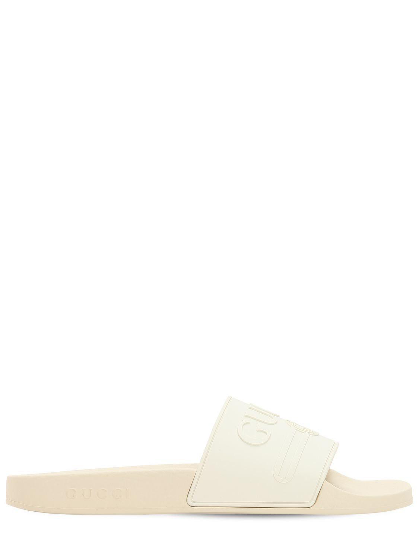 8ac6a2451 Lyst - Gucci Pursuit Rubber Logo Slide Sandals in White