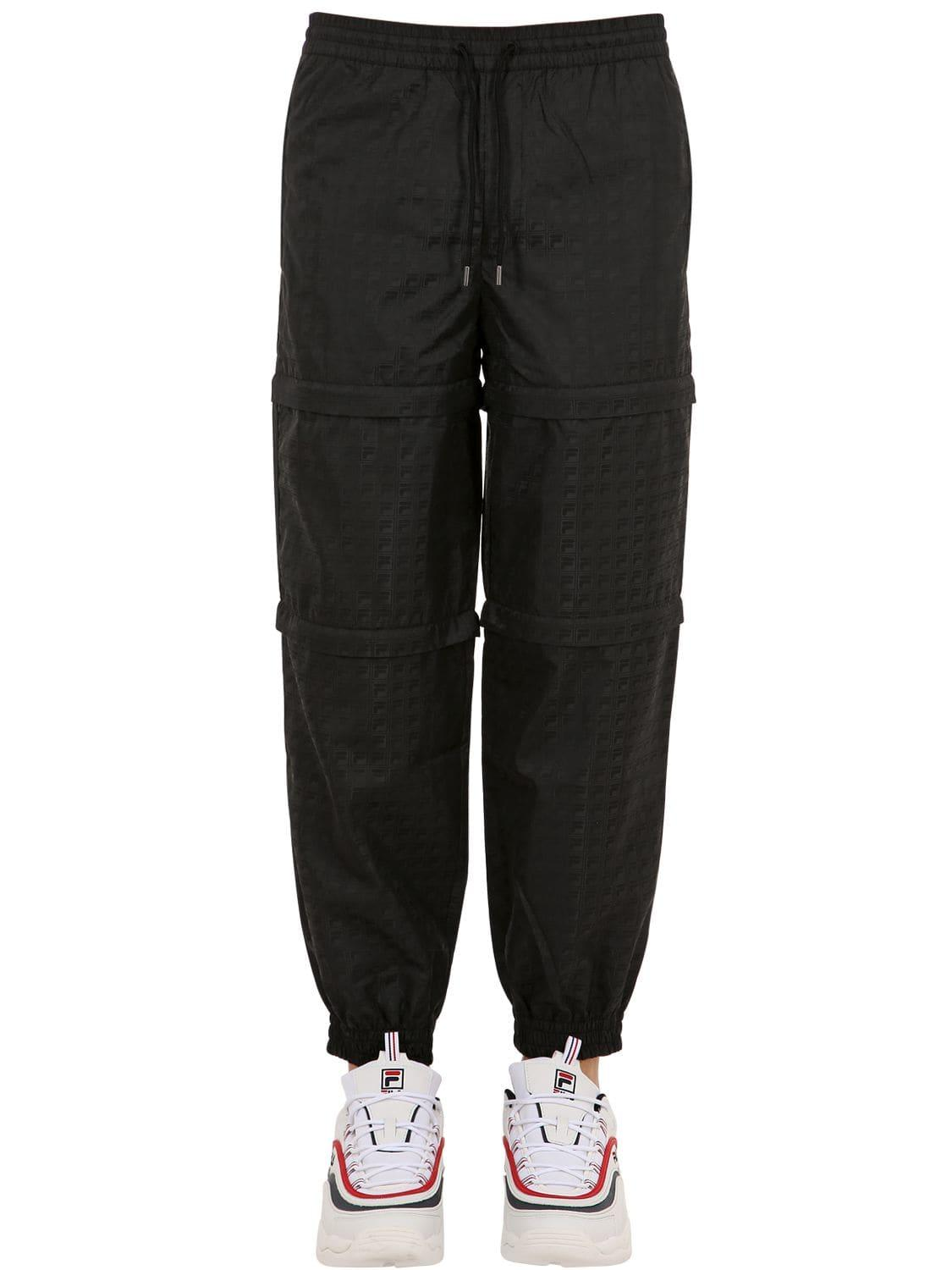 0c0d2259a8fcc Lyst - Fila Layered Panel Woven Pants in Black for Men