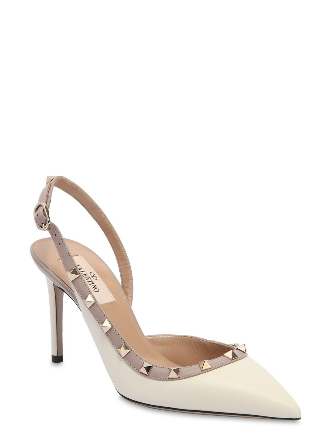 35a517acfbd2 Lyst - Valentino 85mm Rockstud Leather Slingback Pumps in White