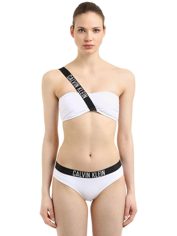 d7e831286601f Haut de bikini bandeau avec lanière logo Calvin Klein en coloris White