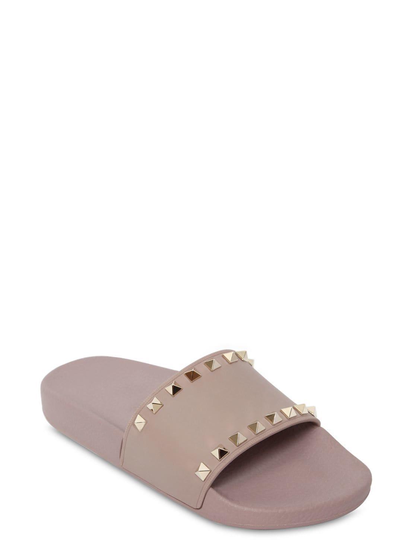 21938ba8673f Lyst - Valentino Rockstud Embellished Pvc Slide Sandals