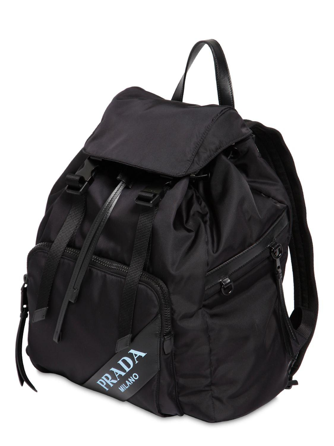 b18ce50b90a8 ... where to buy prada new logo nylon canvas backpack in black lyst 6d847  9de6f
