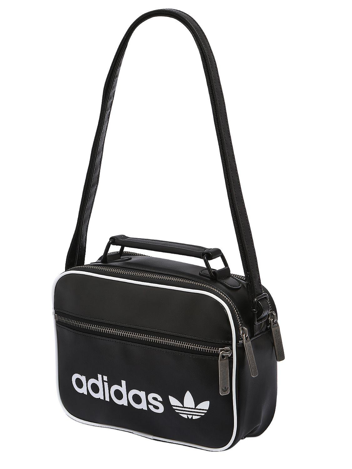 2e5b92a2023 ... Adidas Originals Mini Airliner Vintage Faux Leather Bag in Black - Lyst  hot product 19ee3 fbf5f ...