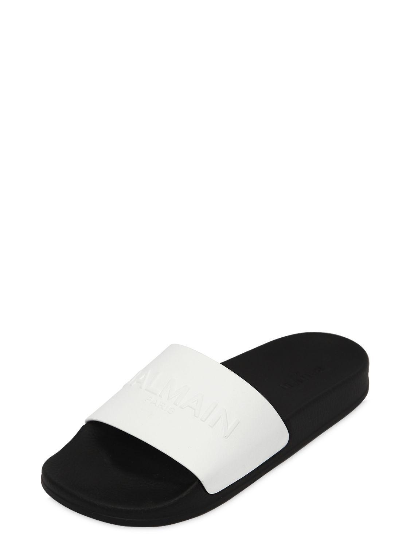 5ce411cb934 Balmain Calypso Logo Leather Slide Sandals in White - Save 50% - Lyst