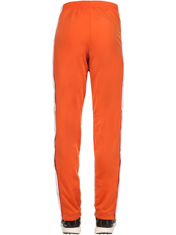 Lyst adidas originali og adibreak tecno - pantaloni della tuta arancione per gli uomini.