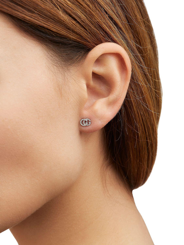 de819b0ba5e Lyst - Gucci Running G Diamond Stud Earrings in White