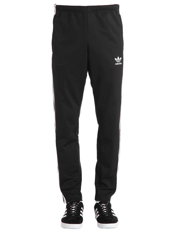 Lyst adidas originali adibreak tricot pantaloncini neri per gli uomini.