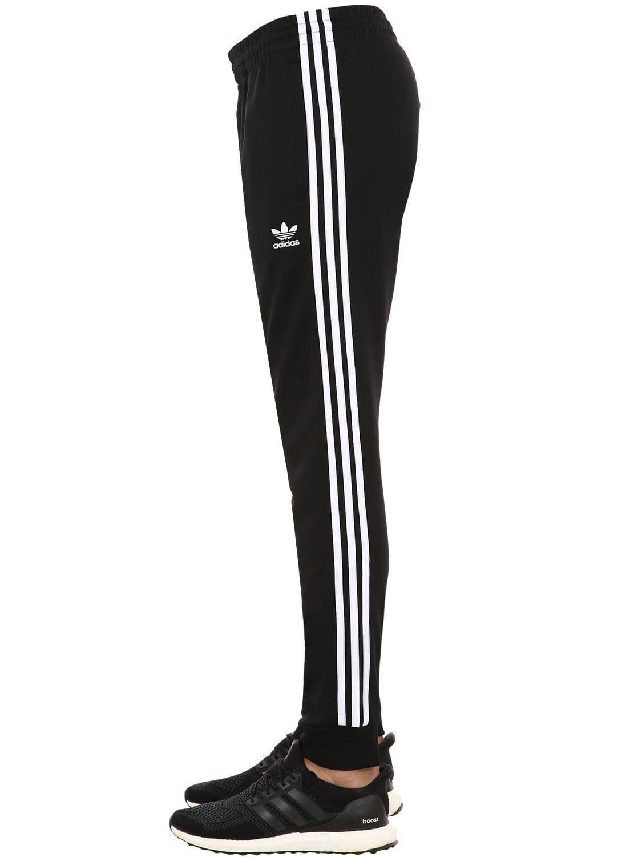 a167415a7d Lyst - adidas Originals Sst Techno Track Pants in Black for Men