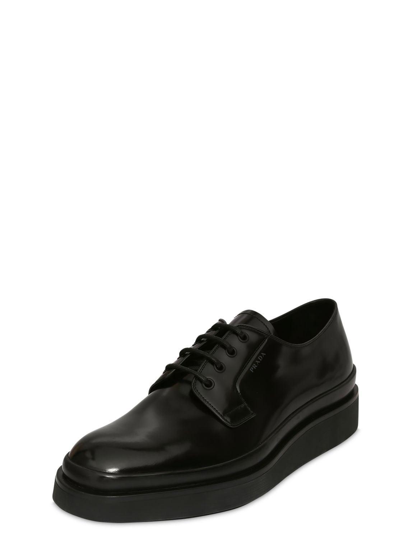 Chaussures Compensées À Lacets En Cuir Prada pour homme en coloris Noir