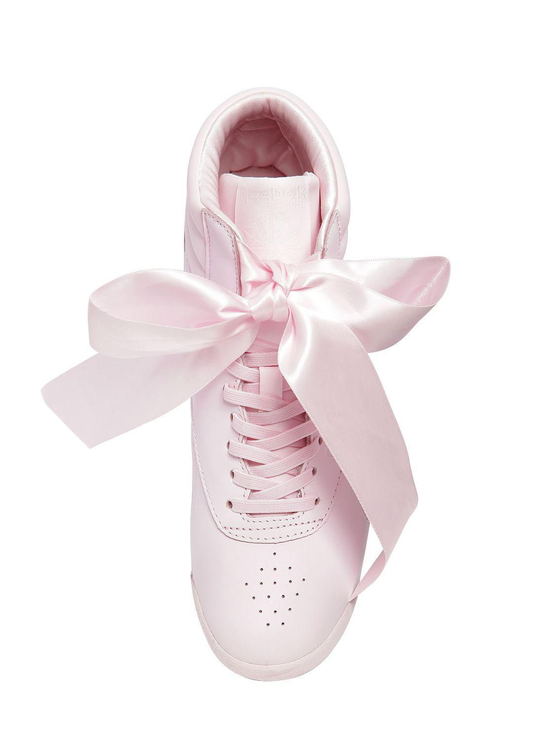 Reebok Freestyle Bow Leather High Top Sneakers in Pink