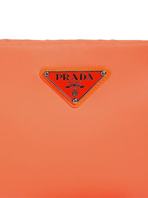 5fedbd1045c845 Prada Small Puffer Nylon Clutch in Orange - Lyst