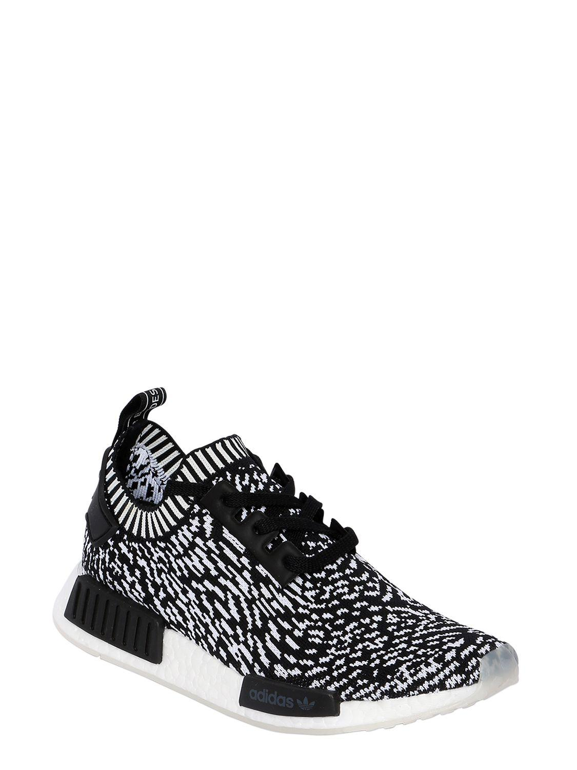 5a9039e8a adidas Originals Nmd R1 Primeknit Sneakers in Black for Men - Lyst
