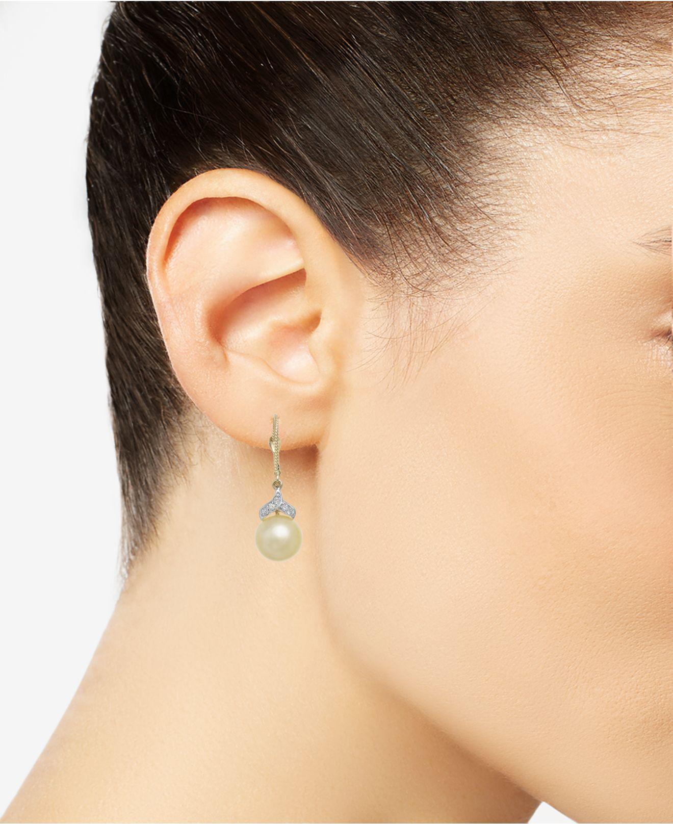Lyst Macy S Cultured Golden South Sea Pearl 9mm And Diamond 1 8 Ct T W Drop Earrings In 14k Gold Metallic