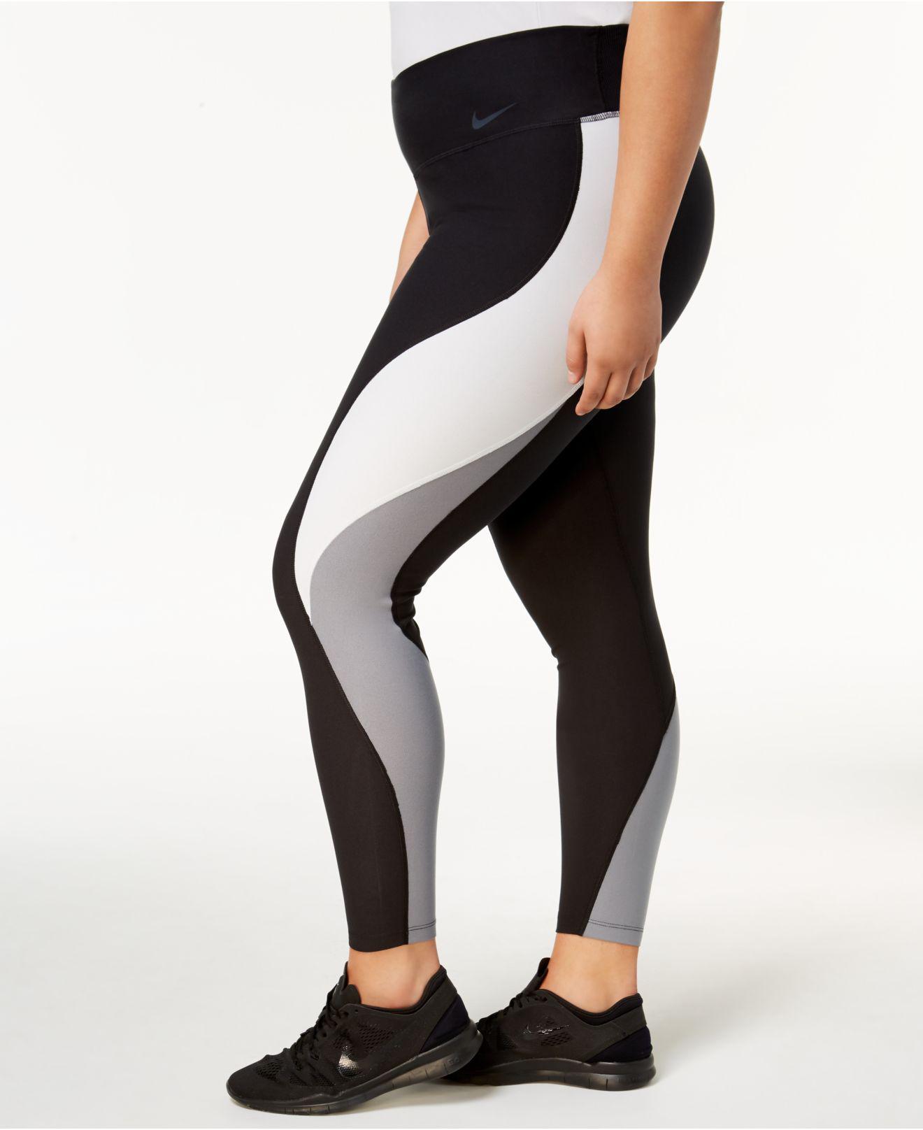 5b06af33a7 Lyst - Nike Plus Size Power Legend Colorblocked Leggings in Black