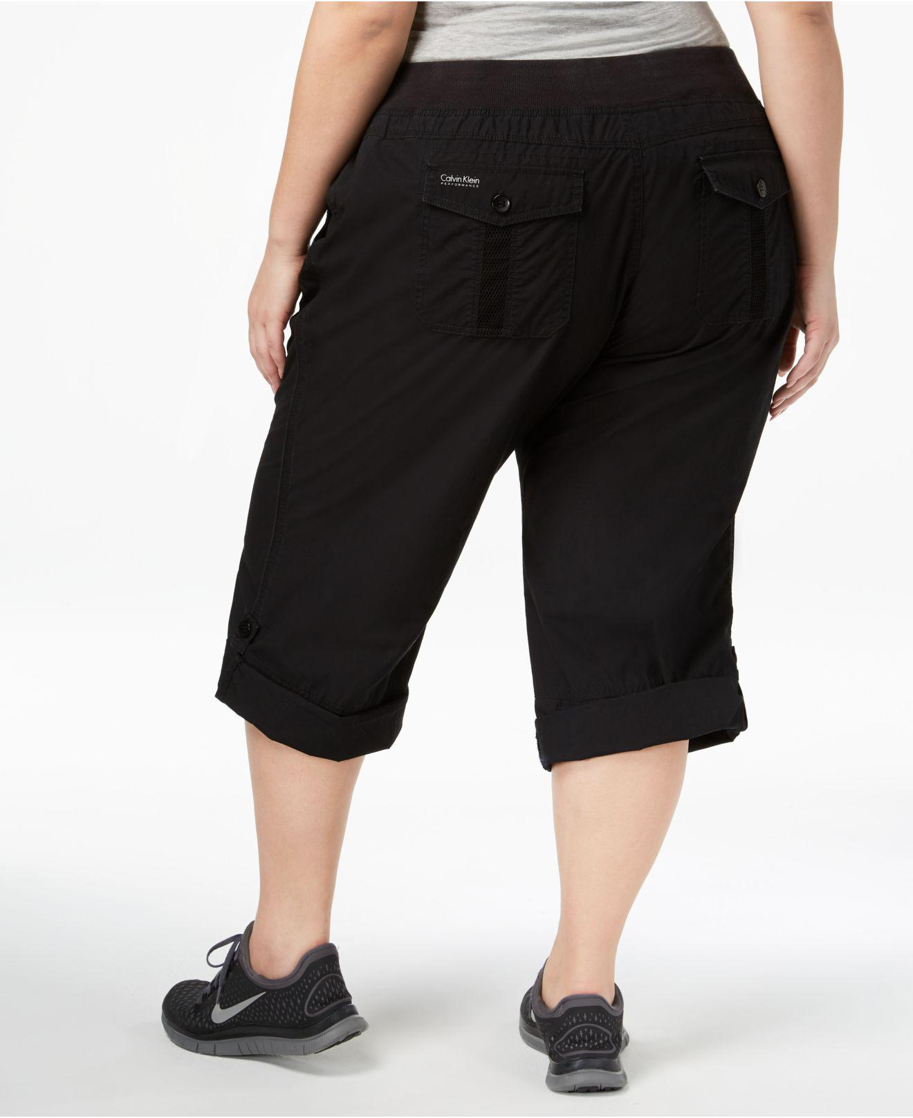 dc028a377e2 Lyst - Calvin Klein Performance Plus Size Roll-tab Cargo Pants in Black