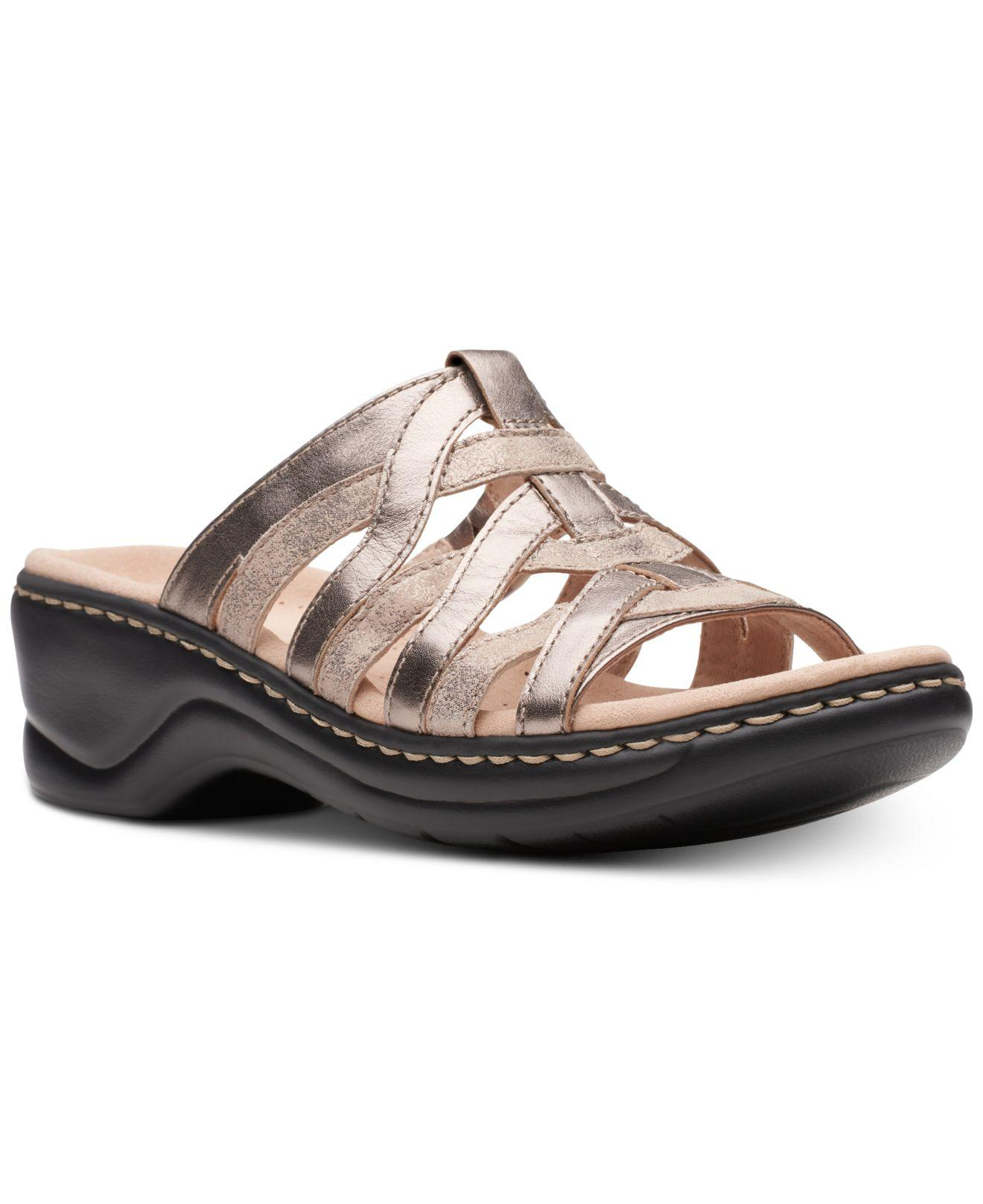 852f68bb91a63f Clarks. Women s Metallic Lexi Mina Sandals ...