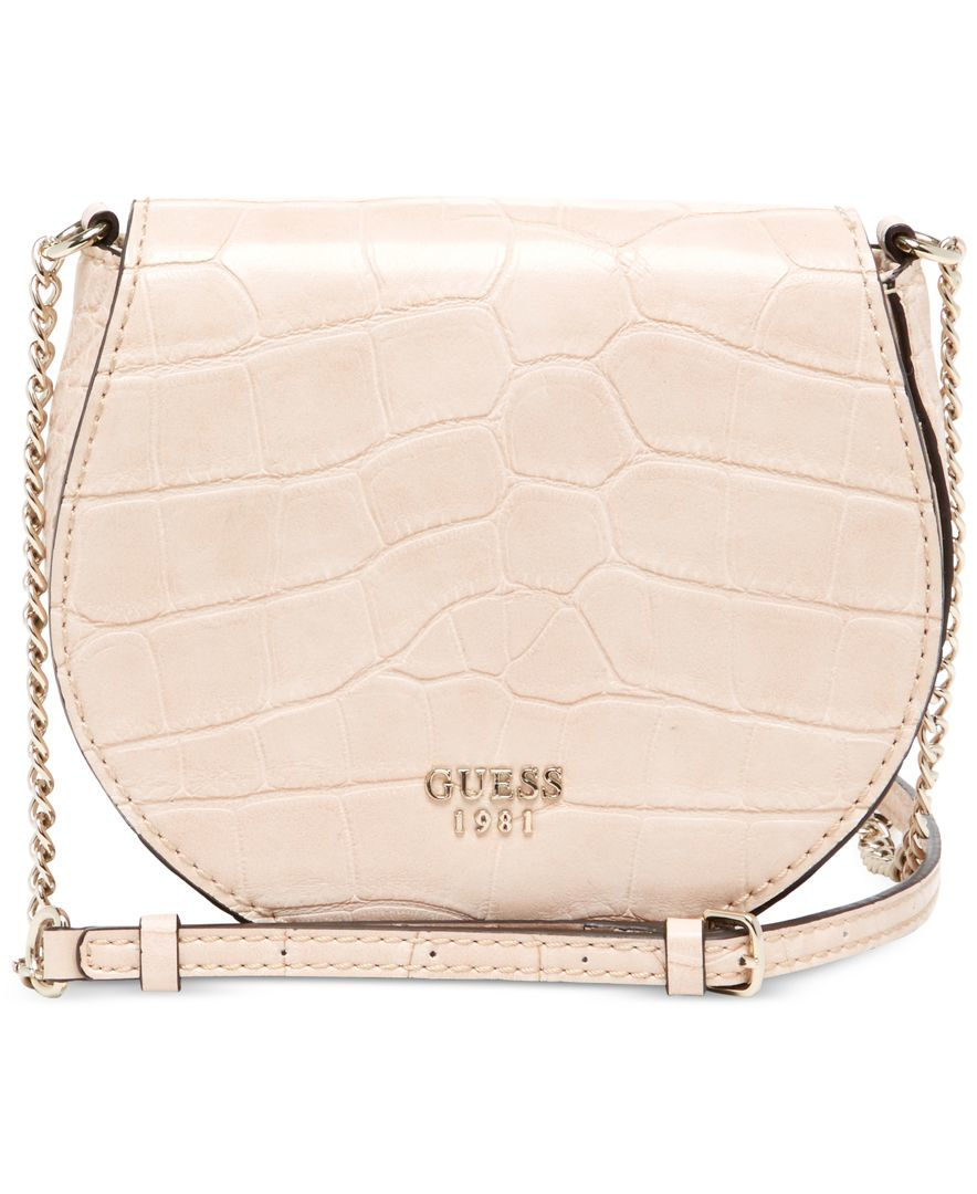 2d9dbf3fc06f Women s quilted black leather crossbody bag with chain strap Accessories  Handbags Guess 7613366423579 PGLBYNI Source · Lyst Guess Cate Mini Saddle  Crossbody ...