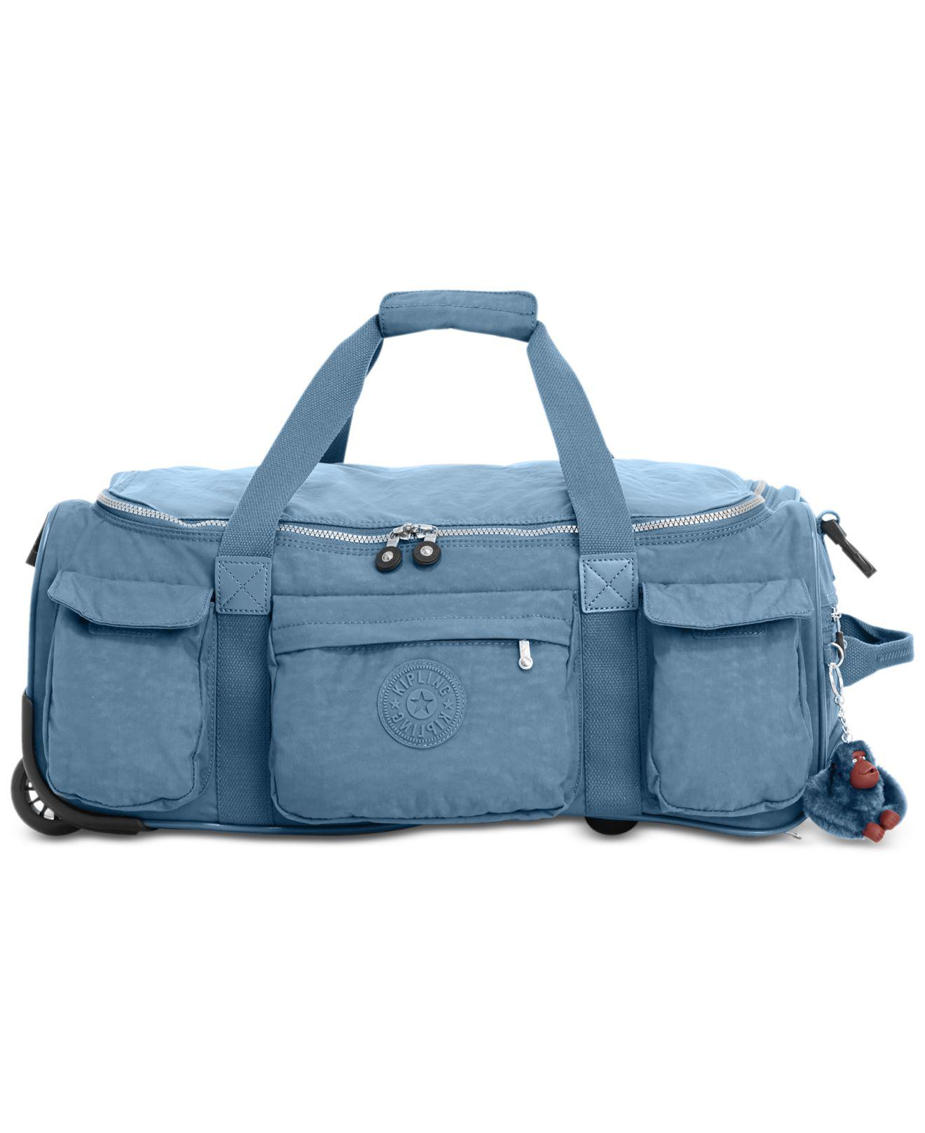 6d088787ebf Kipling Discover Small Carry-on Wheeled Duffle in Blue - Lyst