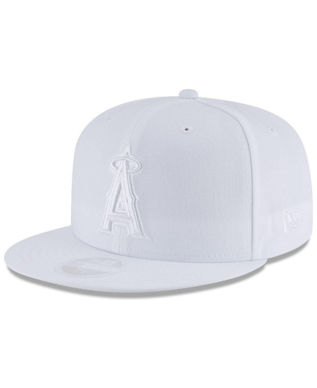 super popular 47633 296fd KTZ - Los Angeles Angels White Out 59fifty Fitted Cap for Men - Lyst. View  fullscreen