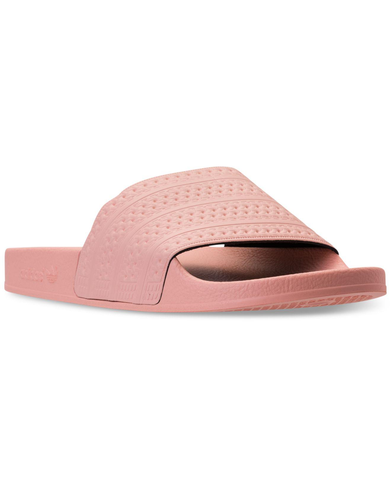 0f396d1f79e844 Lyst - Adidas Men s Adilette Slide Sandals From Finish Line in Pink ...