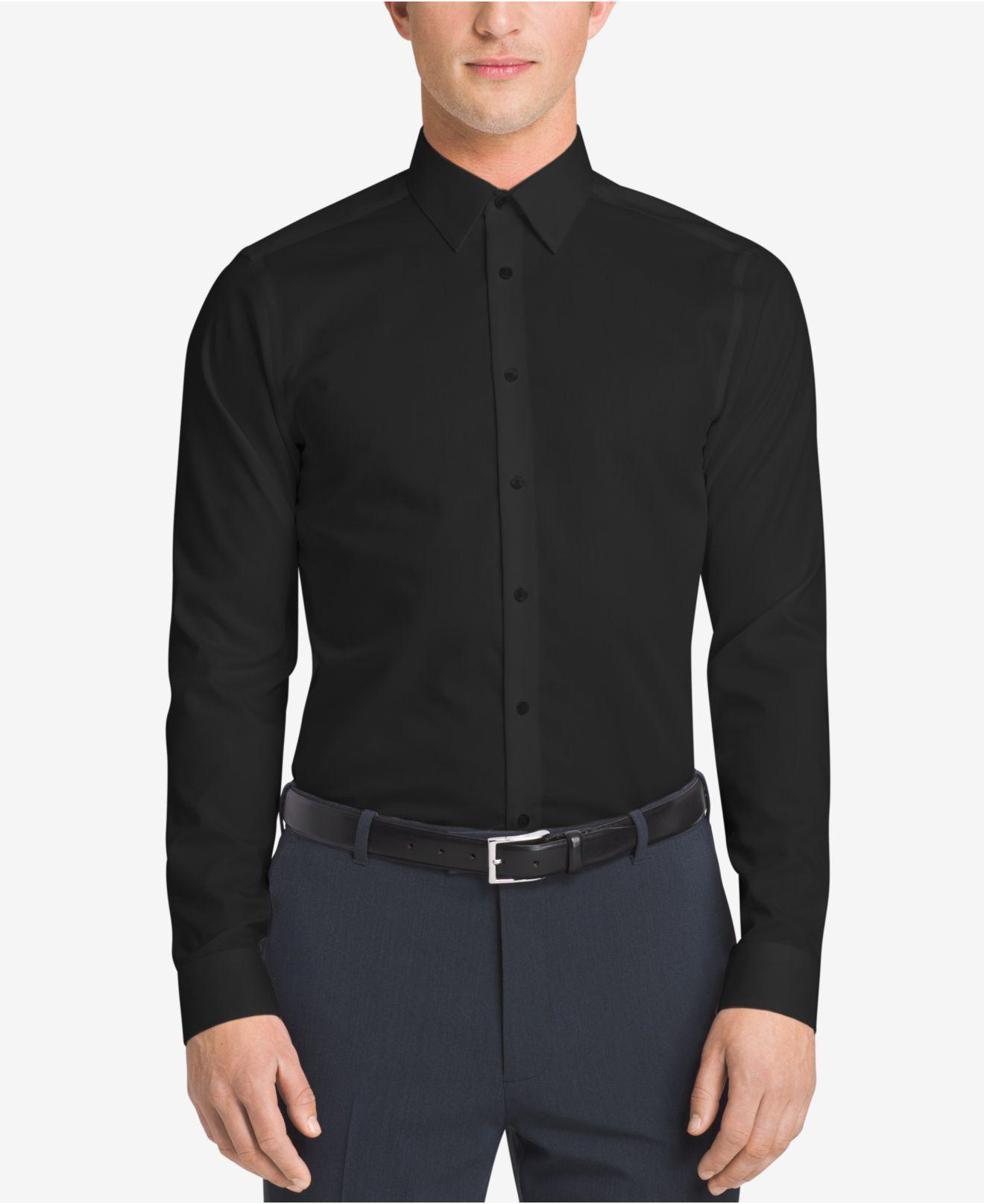 bbdcbc921 Calvin Klein. Black Men s Slim-fit Non-iron Performance Herringbone Dress  Shirt