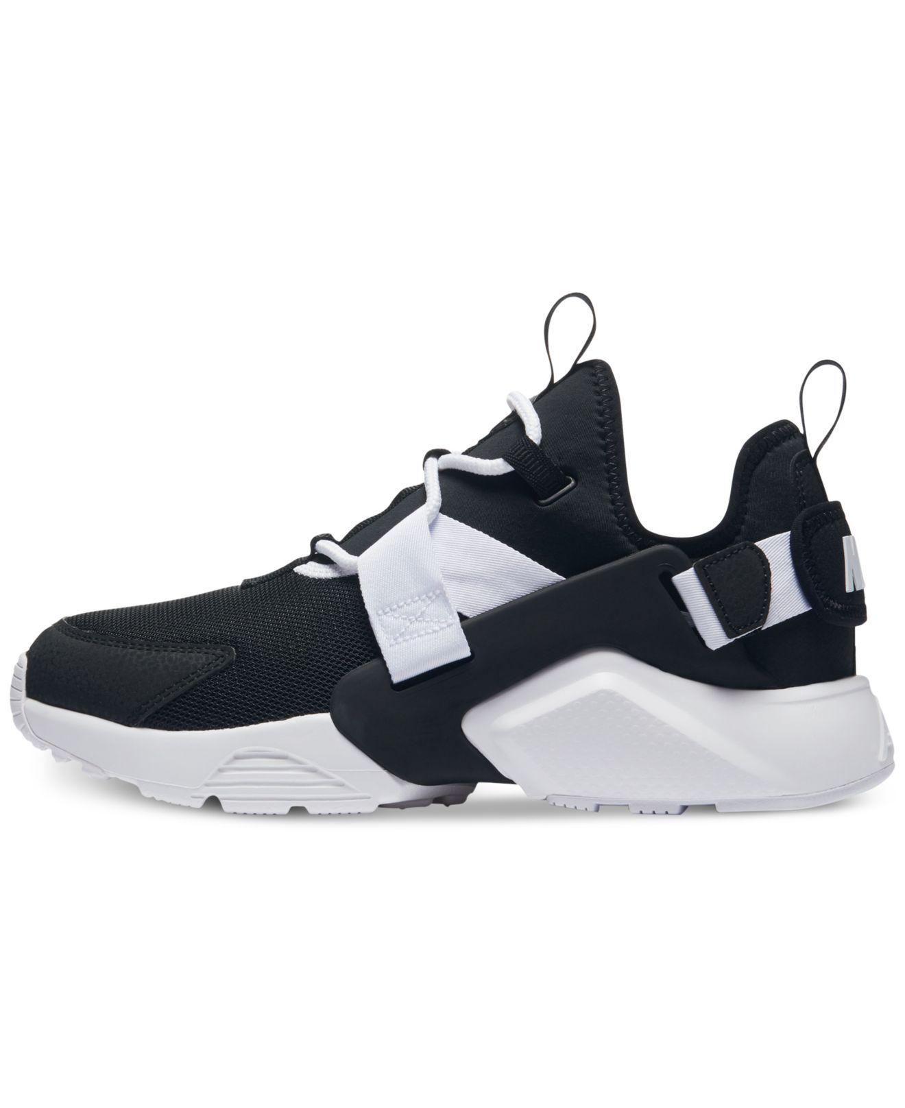 pretty nice a510b 04586 amazon lyst nike air huarache city low casual sneakers from finish line in  black save 25.83333333333333