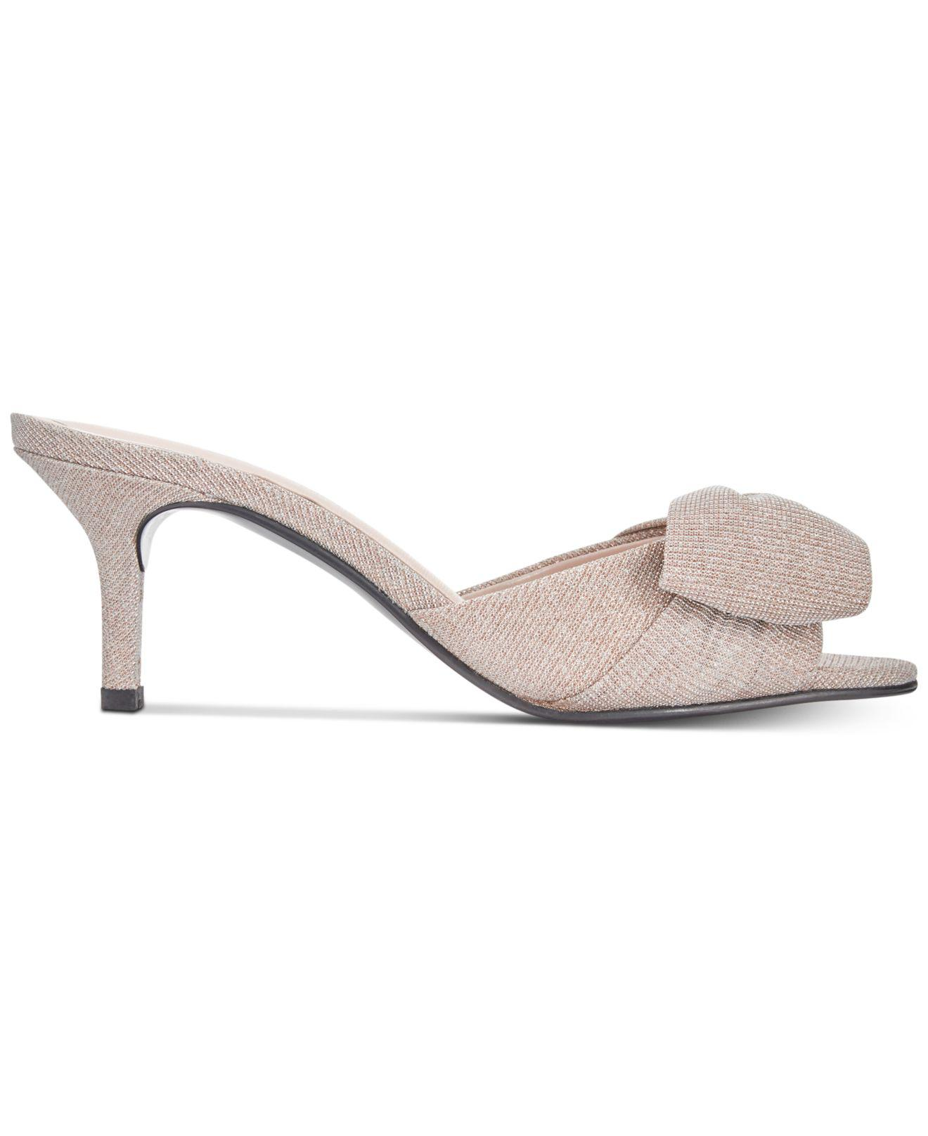 6f4204f6ad3 Caparros Lydia Bow Slide Evening Sandals - Lyst