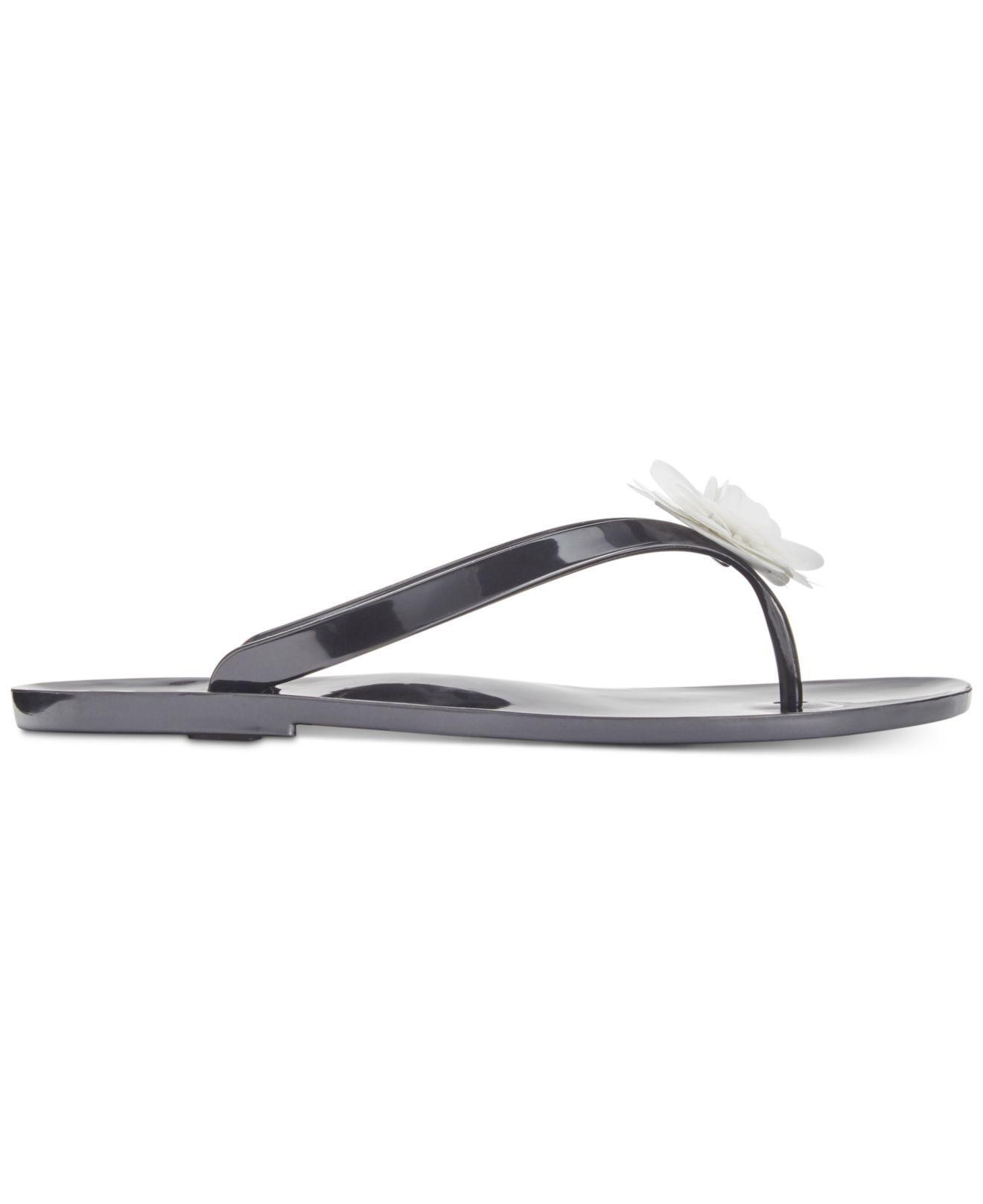 f9130bbceb23 Lyst - Kate Spade Fiorina Jelly Flip Flops in Black