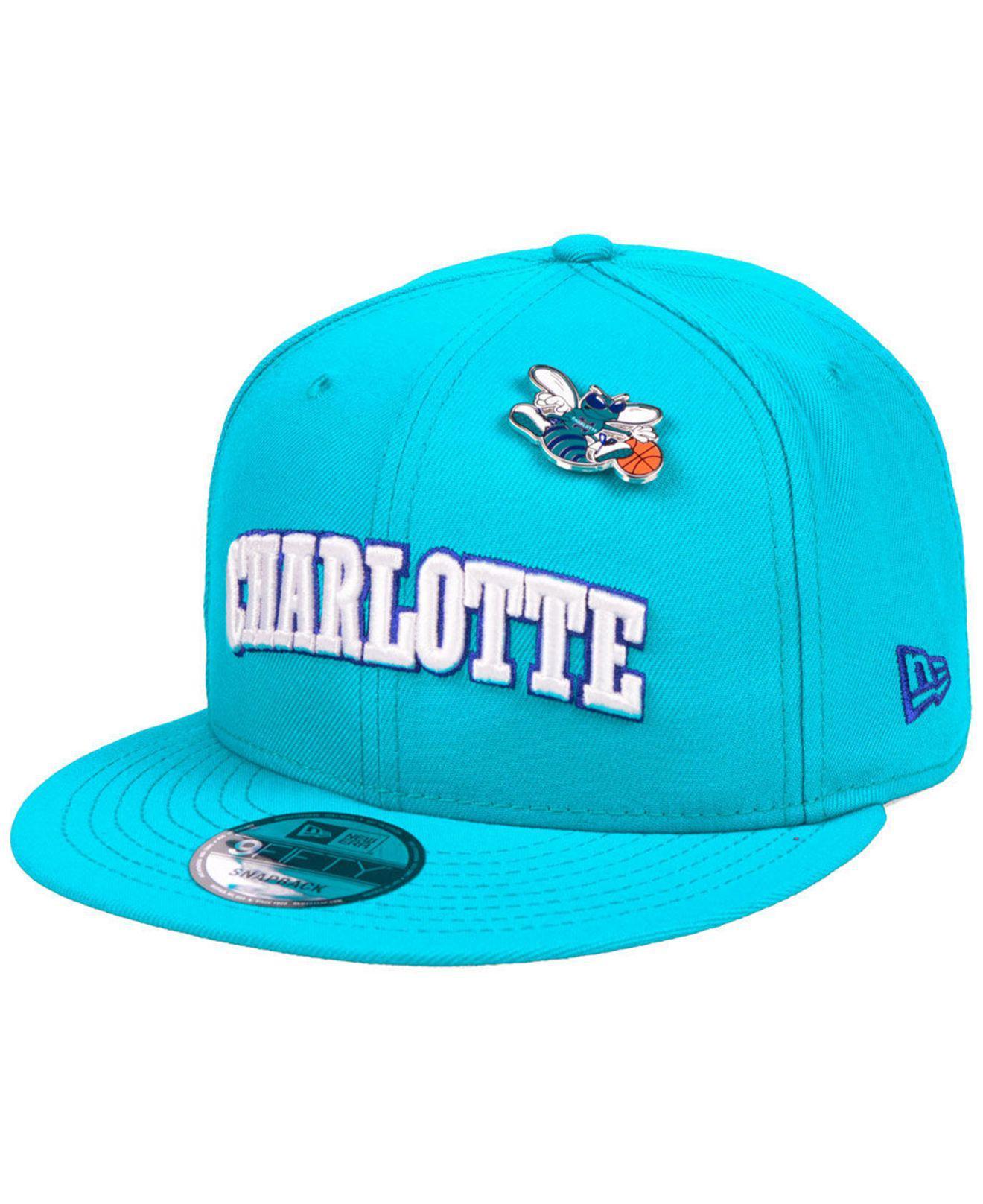 KTZ. Men s Blue Charlotte Hornets Hardwood Classic Nights Pin 9fifty  Snapback Cap 41a46dded