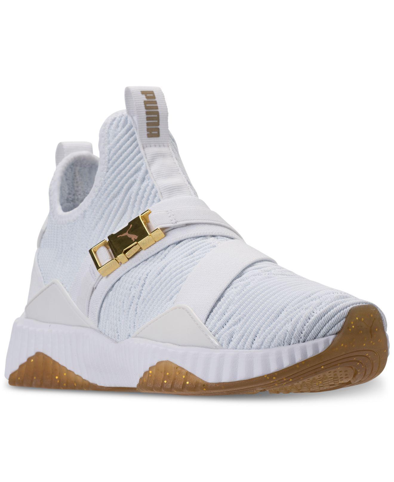 Puma Defy Mid Varsity Sneakers Schwarz Metallic Golden