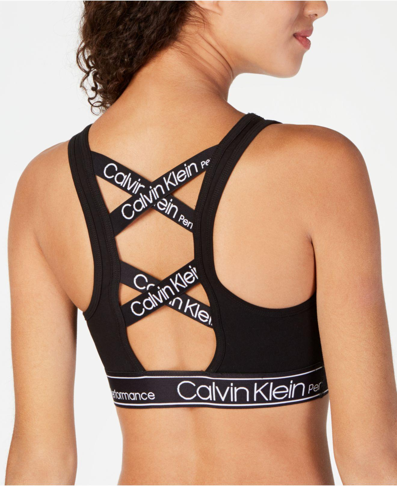 0a8c13855d Lyst - Calvin Klein Performance Logo Strappy-back Medium-impact Sports Bra  in Black