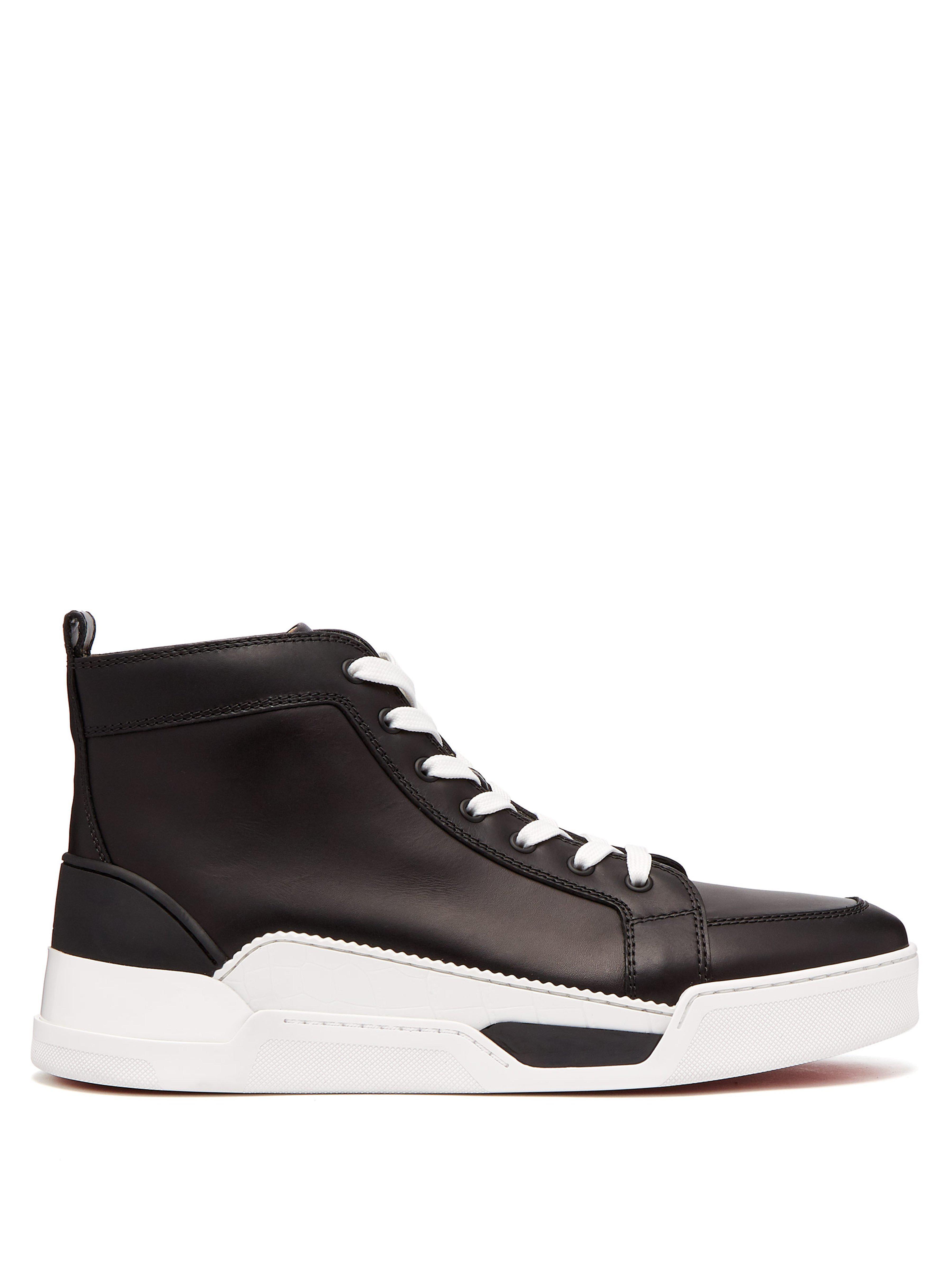 925055c911d Christian Louboutin. Baskets montantes en cuir et caoutchouc Rankick homme  de coloris noir